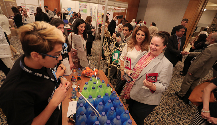 Acting Mission Director Nancy Eslick at a booth at the 2018 Jordan MEL Conference