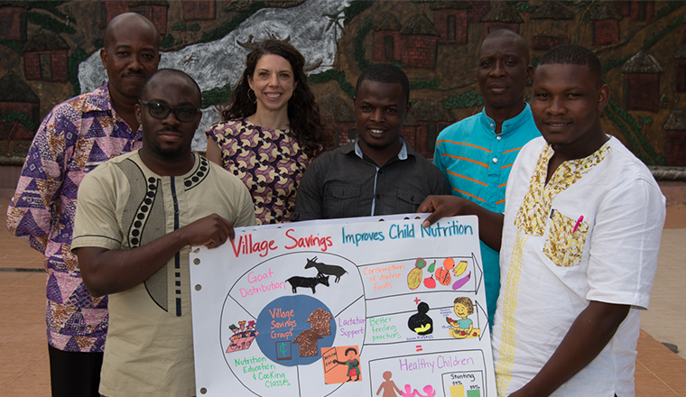 Workshop attendees in Accra, Ghana hold up hand-crafted infographic.