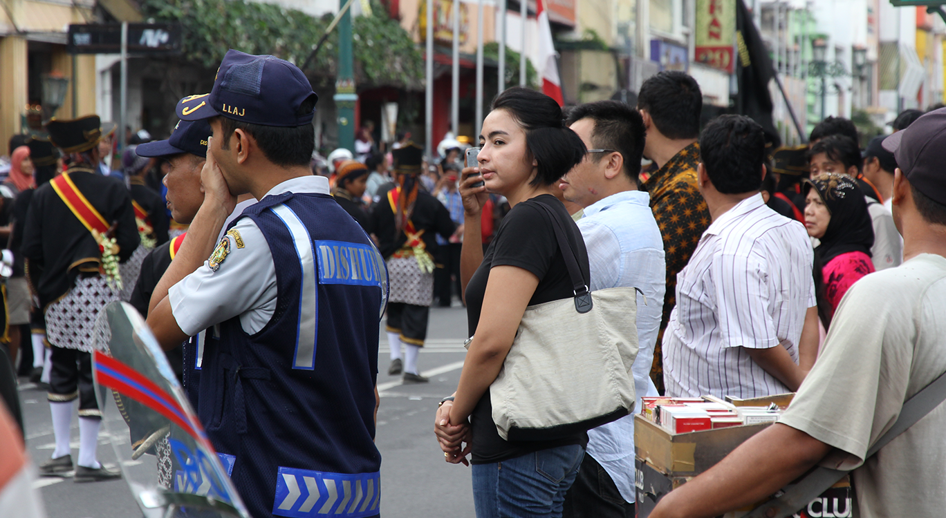 Group of people and officers during parade in Indonesia JUJUR BARENGAN festival