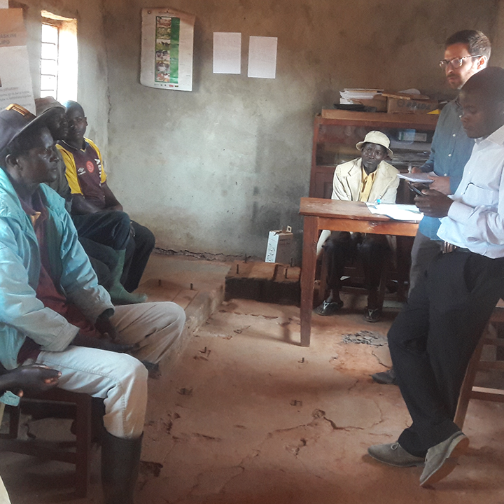 Room of men sitting while facing instructor in Tanzania