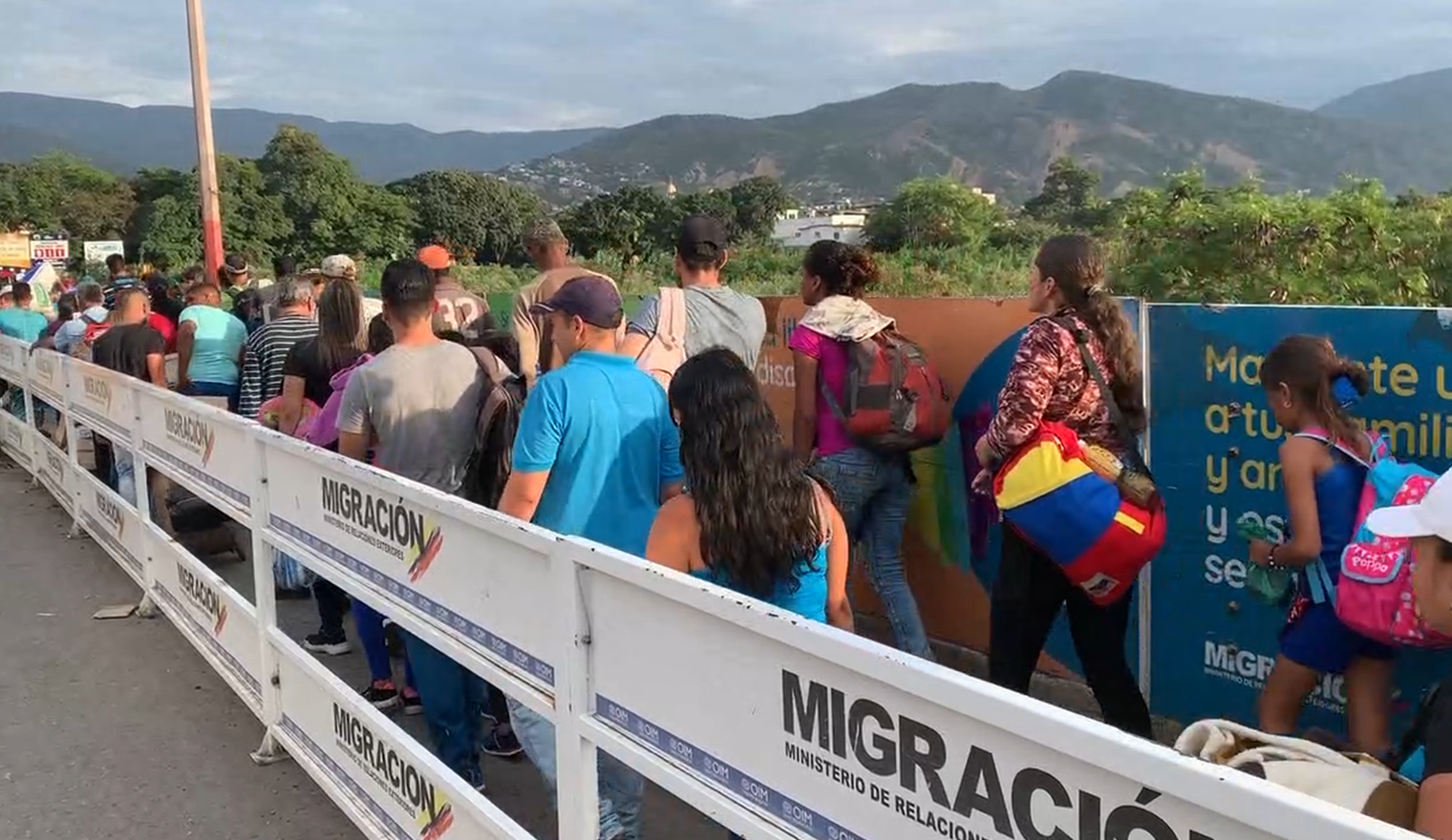 Venezuelans wait in line at the Colombian border