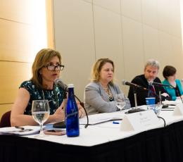 MSI Vice President Ellen Yount speaks on microphone with fellow panelists