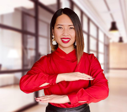 Blog author Jess Ngo poses with arms in Equal sign